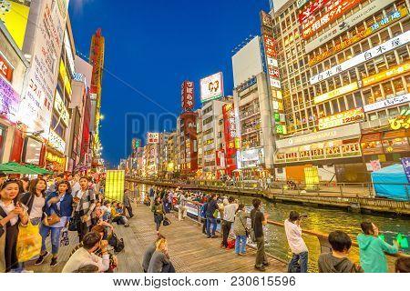 Osaka, Japan - April 29, 2017: Tourists Walking In Night Shopping Street At Dotonbori Canal In Namba