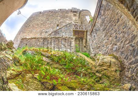 Bottom View Of The Walls Of Eilean Donan Castle Located In Dornie Town Of Scotland, United Kingdom.