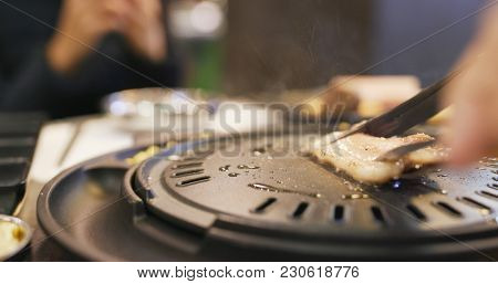 Traditional Korean barbecue in restaurant