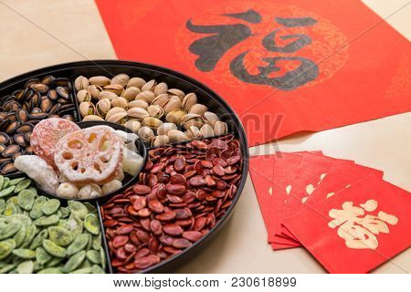 Chinese new year snack tray with red packet and couplet word mean luck