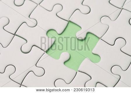 Missing Piece For Business Success Strategy Metaphor Concept, Closed Up Of White Jigsaw Puzzle Missi