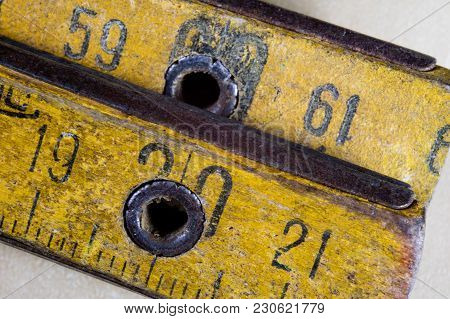 Old Measure Carpentry On A Wooden Workshop Table. Joinery Accessories Shown In A Large Magnification