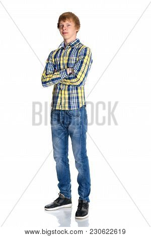 A Young Red-haired Guy In A Shirt And Jeans. Isolated On White Background.