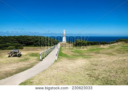 Cape Otway Lighthouse In Grasslandpark With Bench And Overlook At The Ocean At The Great Ocean Road,