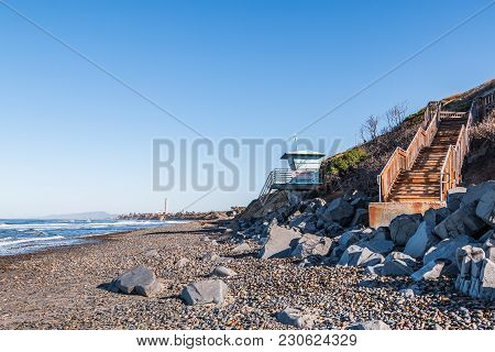 South Carlsbad State Beach In San Diego, California With Lifeguard Tower And Staircase For Beach Acc