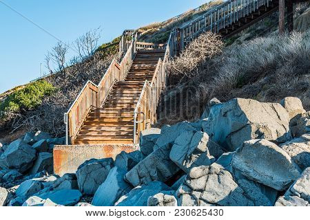 Boulders Near Staircase For Beach Access At South Carlsbad State Beach In San Diego, California.