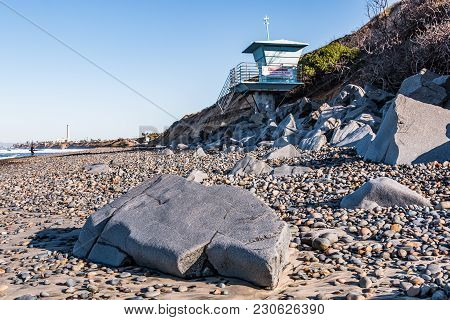 Boulders, Stones, And Lifeguard Tower On South Carlsbad State Beach In San Diego County With Landmar