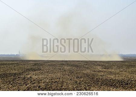 Dust Storm. Tornado In The Field. Clubs Of Dust