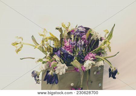 Withered Vintage Flowers Bouquet In A Box On White Background