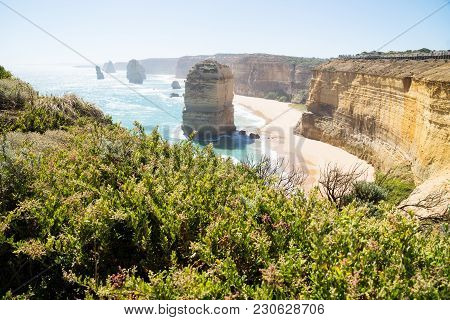 Cliffs And Green Bushes At Twelve Apostels With Backlight At The Great Ocean Road, Victoria, Austral