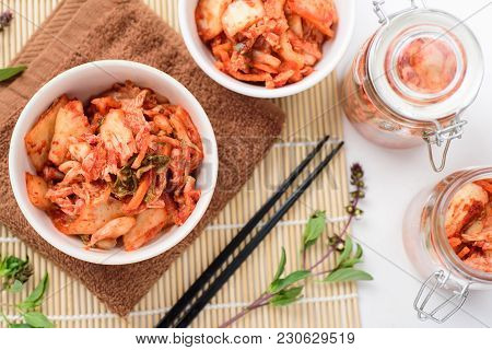 Kimchi Cabbage (korean Food) In A Bowl And Jar, Top View