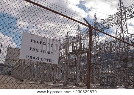 A Property Violators Prosecuted Sign Outside Of An Electrical Power Substation