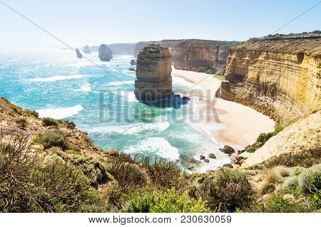 Beach And High Cliffs At Twelve Apostels At The Great Ocean Road, Victoria, Australia