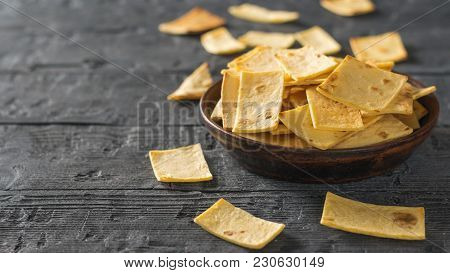 Mexican Tortilla Chips In A Bowl On The Table. A Dish Of Mexican Cuisine.