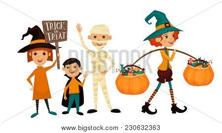 Kids In Halloween Costumes Mummies, Vampire And Witches With Sign Trick Or Treat. Kids In Halloween