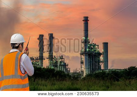 Engineering Is Use Notebook Check And Standing In Front Of Oil Refinery Building Structure In Heavy