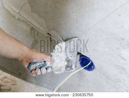 Wall Socket Installation.work On Installing Electrical Outlets. Electrician Prepares The Wiring Fitt