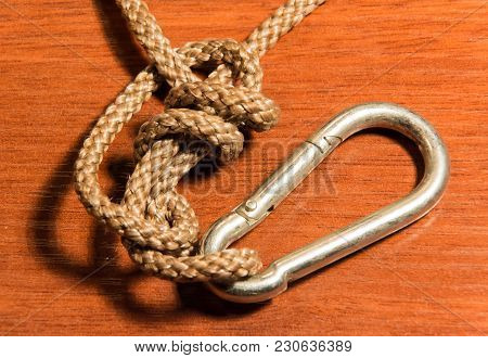 Climbing Rope Knotted On A Wooden Background