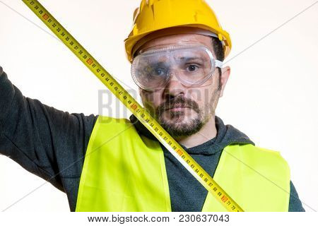 Odd job, a man who wants to do a work without knowledge, work without experience. Do it yourself, man dressed in yellow builder helmet with protective glasses ready to start the construction work