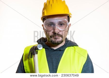 Occupation, Do it yourself, man dressed in yellow builder helmet with protective glasses ready to start the construction work