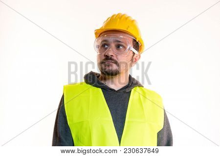 Engineer Do it yourself, man dressed in yellow builder helmet with protective glasses ready to start the construction work
