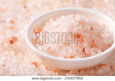 bowl of coarse grained salt on coarse grained salt background - detail