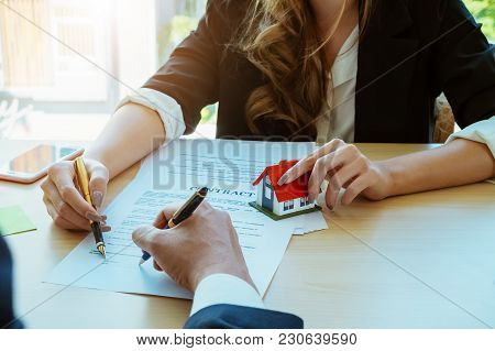 Agreement Paper,estate Agent Gives Pen And Documents Agreement With Customer To Sign Contract.