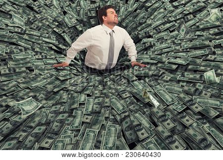 Businessman Swallowed By A Big Black Hole Of Money. Concept Of Failure And Economic Crisis