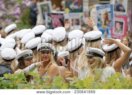 Stockholm, Sweden - Jun 13, 2017: Smiling Students Wearing White Graduation Caps After Graduation At