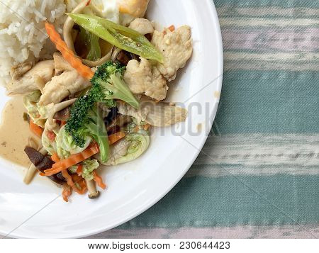 Stir-fried Vegetables With Thai Jasmine Rice And Fried Egg In White Dish As Food For People Who Need