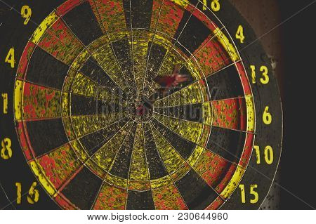 Old Dart Board With Dart Arrow. Focus On Target Business Concept