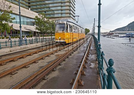 BUDAPEST, HUNGARY - JUNE 6, 2013: Tram passing by at the flooding river Danube. Record breaking water level is expected in a few days.