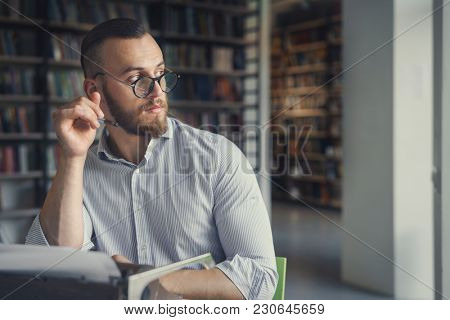Young man at work in the library