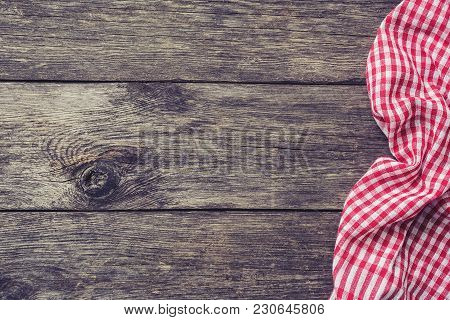 Red Kitchen Textile On Rustic Wood. Picnic Summer Background. Top View With Copy Space For Text