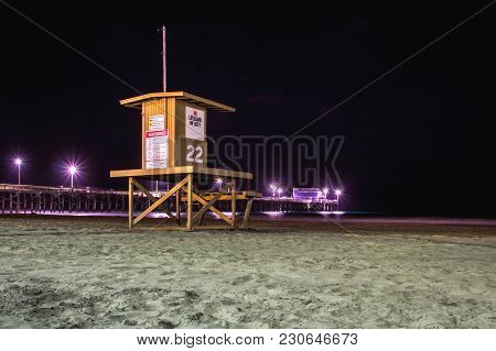 Night View Of A Lifeguard Tower At Newport Beach, California