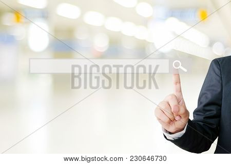 Businessman Hand Touching Blank Search Bar Over Blur Background, Business And Technology Concept, Se