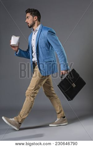 Full Length Of Young Surprised Businessman Is Opened-mouthed And Wide-eyed, Holding Breifcase And Be