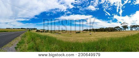 Spectacular Panorama Of Countryside Road And Field With Straw Bales On Sunny Day. Australian Rural L
