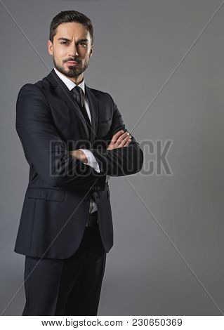 Portrait Of Handsome Reflective Man. He Standing And Looking At The Camera With Calm And Confident.