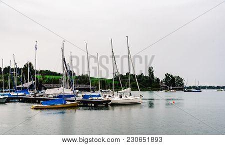 Mattsee, Austria - August 6, 2017: Sailing Boats Moored In Mattsee Lake A Rainy Day