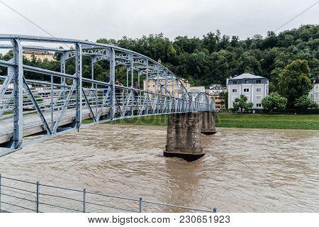 Salzburg, Austria - August 6, 2017: Steel Bridge Over River In Salzburg A Cloudy Day