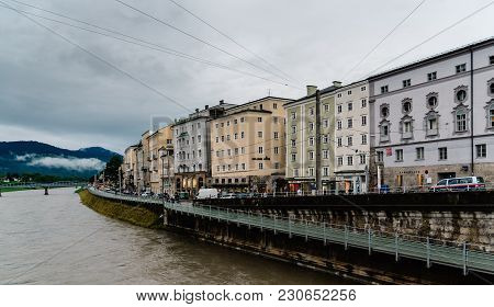 Salzburg, Austria - August 6, 2017: Scenic View Of River  In Salzburg. The Old Town Of Salzburg Is I
