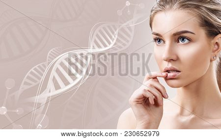 Portrait Of Sensual Woman In Dna Chains. Over Beige Background.