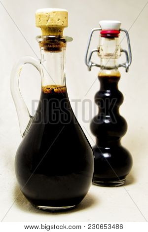 Soft Focus Of Traditional Balsamic Vinegard Of Modena, Produced From Cooked Grape Must, Aged At Leas