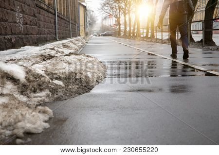 Melting Snow In The City Streets. Spring Background