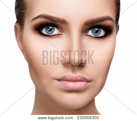 Close-up Portrait Of Young Woman With Smokey Eyes Make-up.