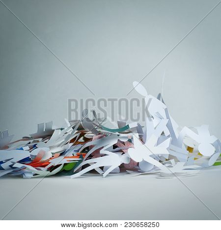 Lot Of Paper Men Piled In A Heap.the Concept Of Crisis