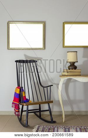 Interior Shot Of Classic Rocking Chair And Wooden Ornate Brown Desktop Photo Frame On Old Style Vint
