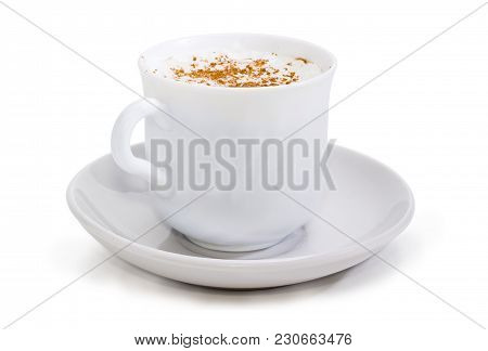 Coffee With Foamed Cream Sprinkled With Cinnamon Powder In The White Cup On The Saucer Closeup At Se