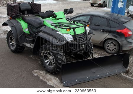 Perm, Russia - February 15, 2017: Quad Bike, Suitable For Snow Removal, Stands On The City Street.
